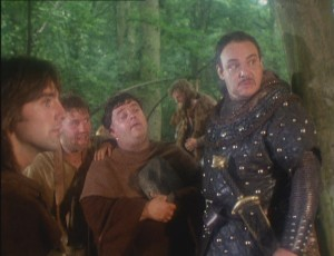 Screenshot from The King's Fool: Michael Praed as Robin, Ray Winstone as Scarlet, Phil Rose as Tuck, Cline Mantle in the back as Little John, and John Rhys Davies as Lionheart.