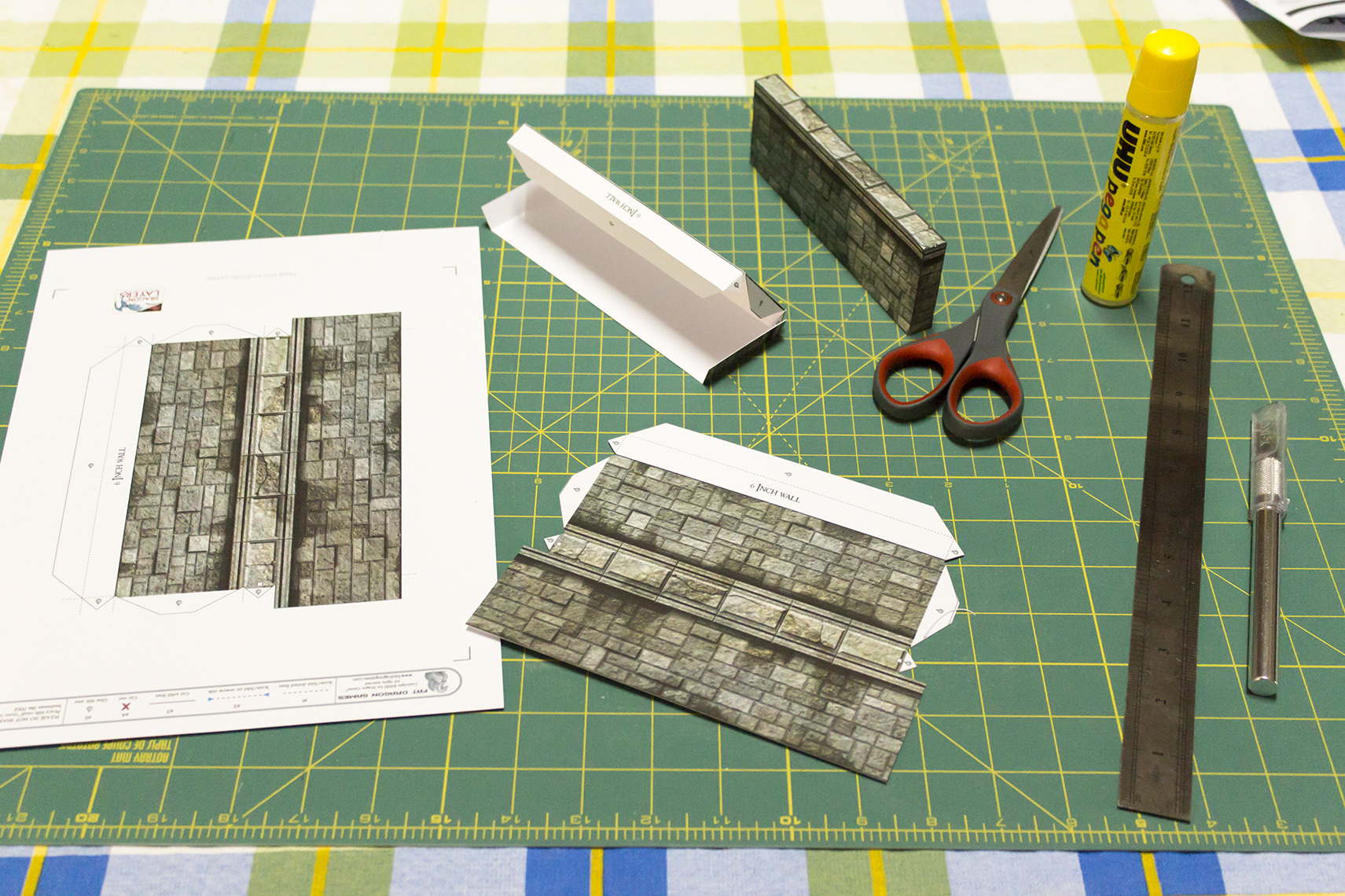 A six-inch wall in various stages of construction - printout, cut and scored, test folded and finished.